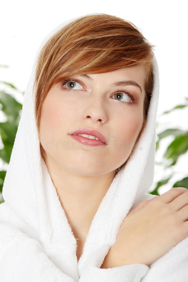 Woman wearing bathrobe royalty free stock photos