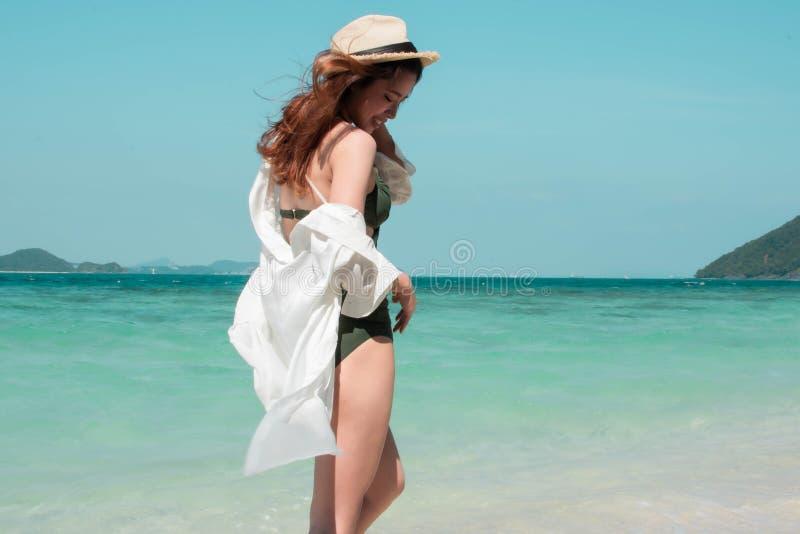 woman wearing bikini is standing on the beach stock images
