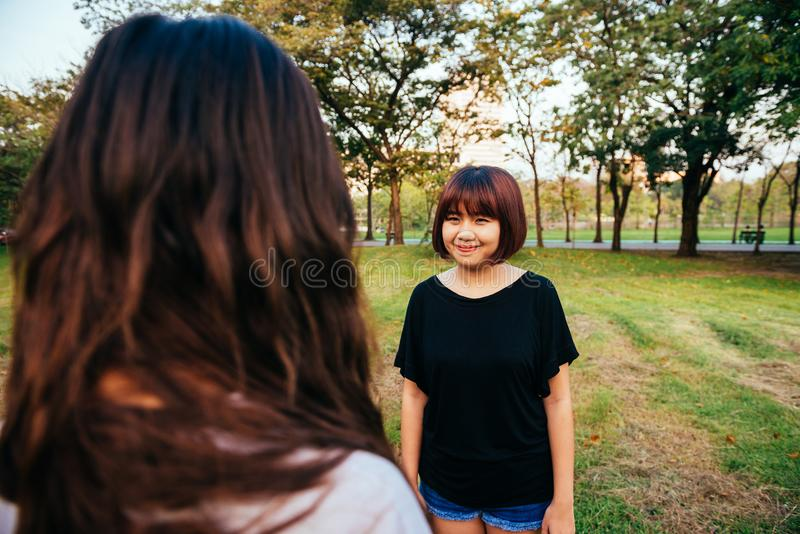 Woman Wearing Black Boat-neck Shirt on Green Grass royalty free stock images