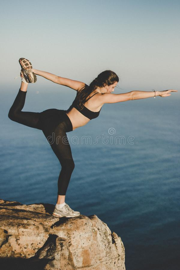Woman Wearing Black Bra and Pants on Top of the Mountain Near Lake royalty free stock photos