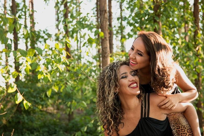 Woman Wearing Black Camisole Beside Woman in Black Dress royalty free stock images