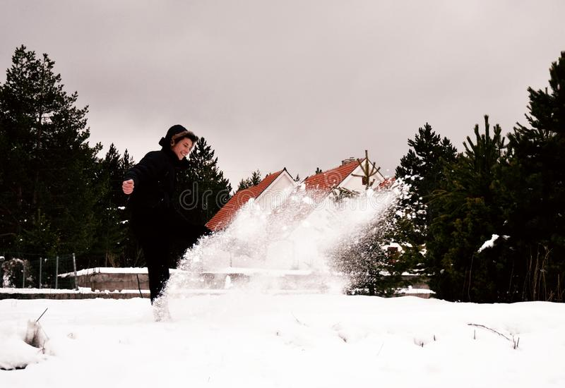 Woman Wearing Black Coat While Playing with Snow royalty free stock photography