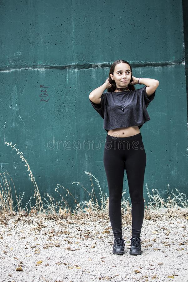 Woman Wearing Black Crew-neck Crop-top and Black High-waist Fitted Leggings stock photography