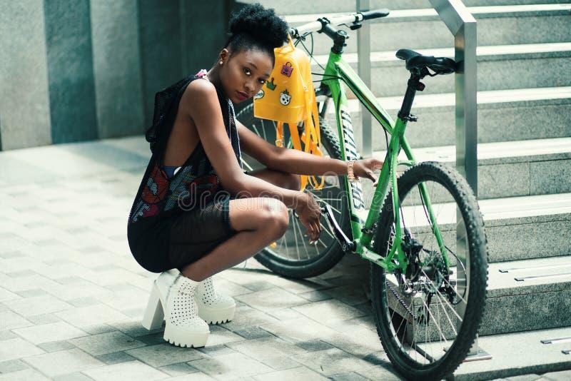 Woman Wearing Black Dress Seating Near Green Bicycle royalty free stock images