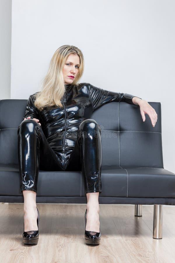 Woman wearing black extravagant clothes stock photos
