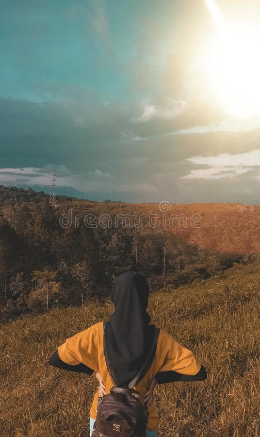 Woman Wearing Black Headdress on Top of Mountain royalty free stock images