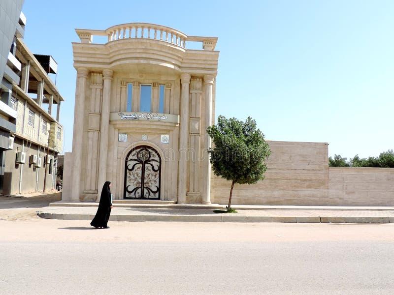 Woman wearing black hijab walking on the streets of Karbala, Iraq stock image