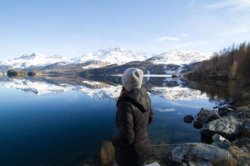 Woman Wearing Black Hooded Jacket Watching Mountain royalty free stock photo