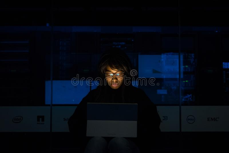 Woman Wearing Black Hoodie Jacket Holding Grey Laptop Computer royalty free stock photography