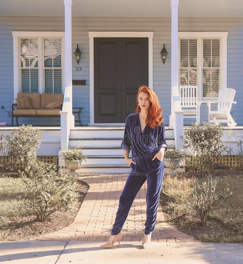 Woman Wearing Black Jumpsuit Standing Near the House stock images