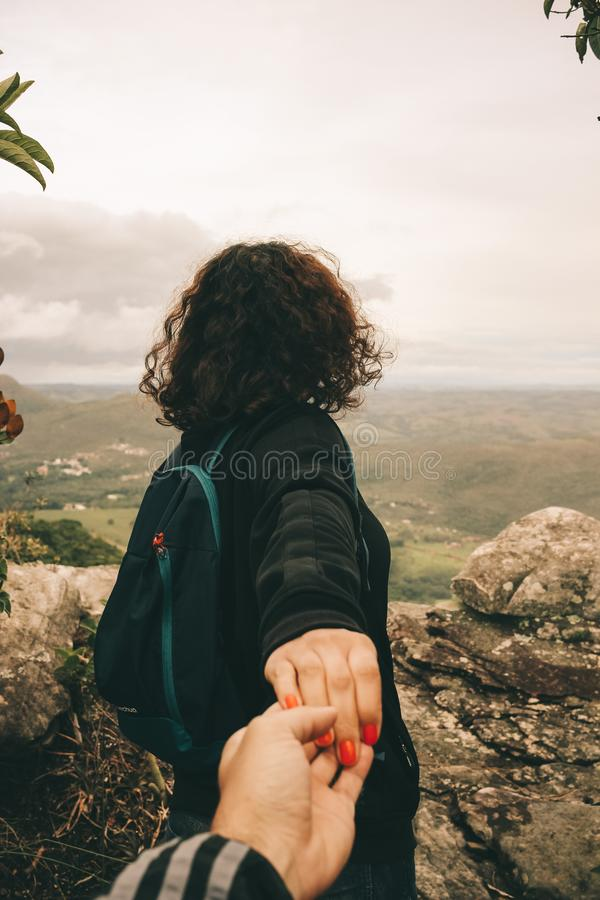 Woman Wearing Black Long-sleeved Shirt Holding Someone's Hand stock photography