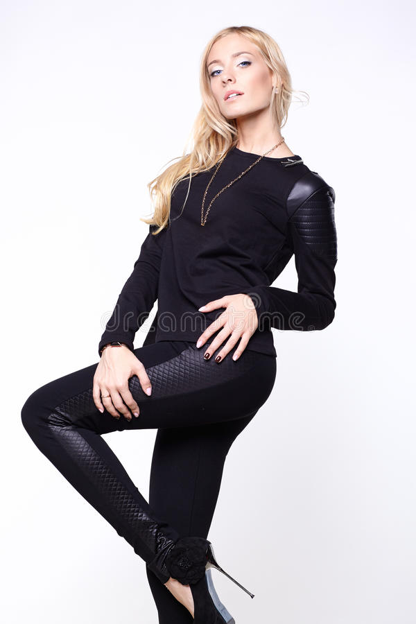Woman wearing black pants, shoes and sweater. Beautiful young woman wearing black pants, shoes and sweater stock images