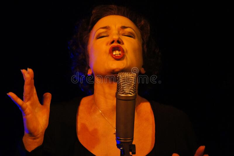 Woman Wearing Black Scoop Neck Shirt Using Microphone With Stand Free Public Domain Cc0 Image