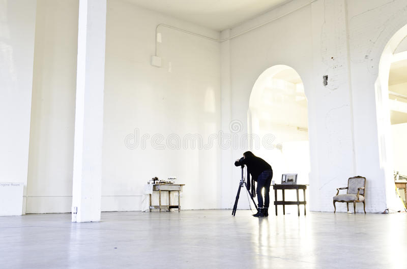 Woman Wearing Black Shirt And Blue Pants Near A Camera Tripod In The Middle Of A White Wall Room Free Public Domain Cc0 Image