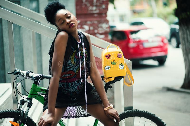 Woman Wearing Black Sleeveless Top With Green Hardtail Bicycle at the Back stock photos