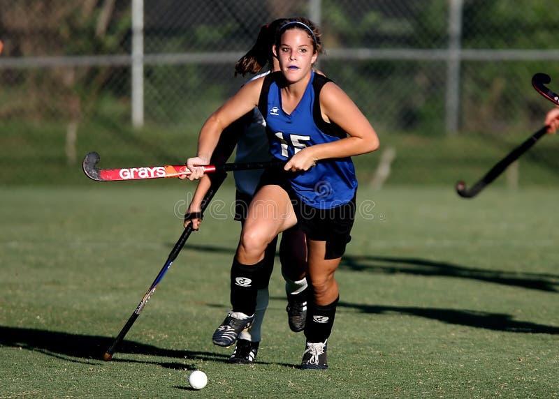 Woman Wearing Blue and Black Jersey Holding Field Hockey stock photo