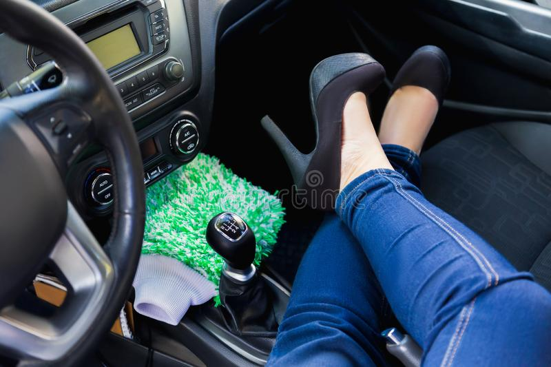 Woman sits inside the car stock images