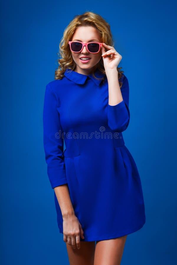 Woman wearing blue dress royalty free stock image