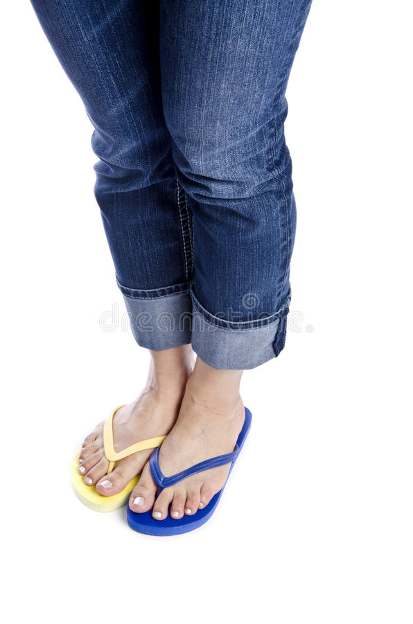 Woman Wearing Blue Jeans And Flip Flops #3 Stock Images