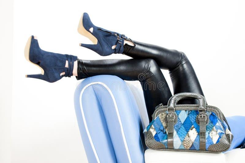 Woman wearing blue shoes stock photo