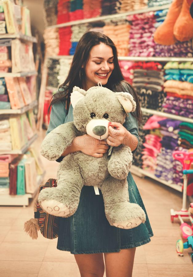 Woman Wearing Blue Top and Blue Denim Skirt Hugging a Brown Bear Plush Toy royalty free stock photos