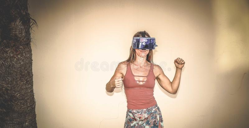Woman Wearing Blue Vr Headset stock photo