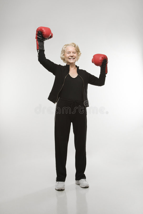 Woman wearing boxing gloves. stock images