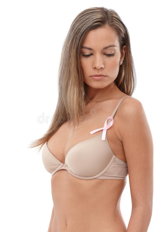 Download Woman Wearing Breast Cancer Awereness Ribbon Stock Photography - Image: 33569992