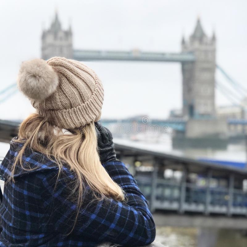 Woman Wearing Brown Beanie Holding Smartphone stock photography