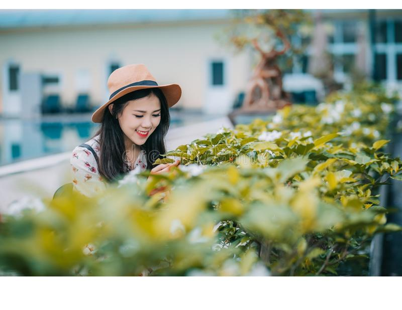 Woman Wearing Brown Hat Standing Near Plants royalty free stock photo