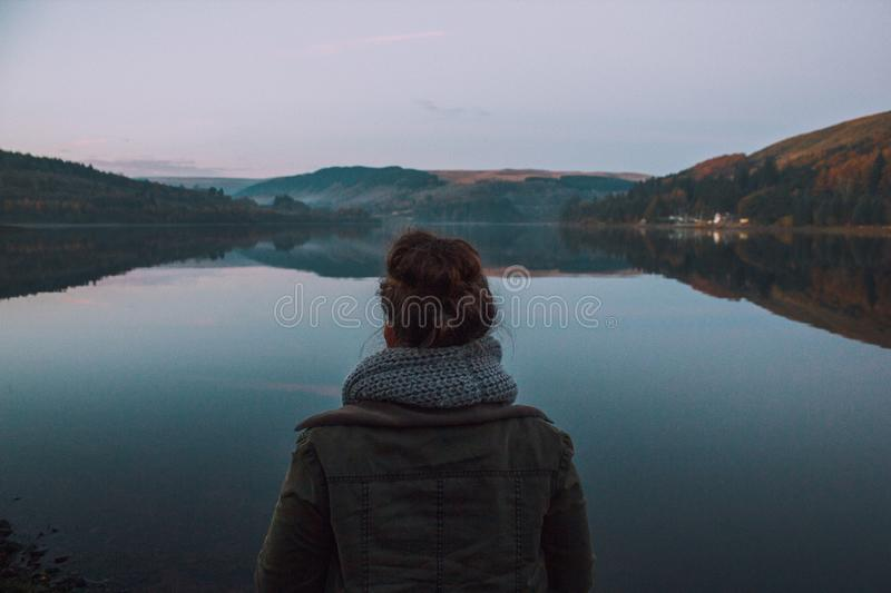 Woman Wearing Brown Leather Standing Near Body Of Water Surrounded A Mountains Free Public Domain Cc0 Image