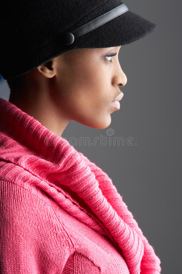 Free Woman Wearing Cap And Knitwear In Studio Stock Photos - 14455393