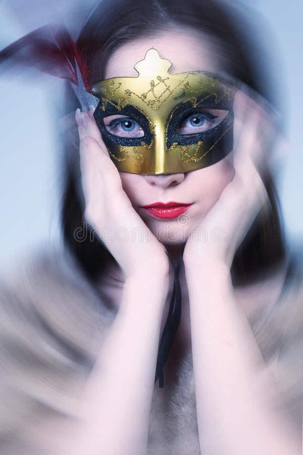 Woman wearing carnival venetian mask on blur background. royalty free stock photography