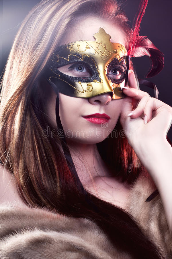 Woman wearing carnival venetian mask on blur background. royalty free stock image