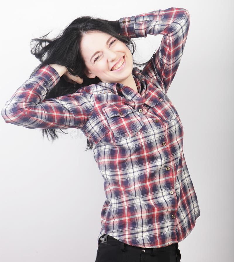 Woman wearing casual clothes, posing on white background. Beautiful young woman wearing casual clothes, posing on white background royalty free stock image