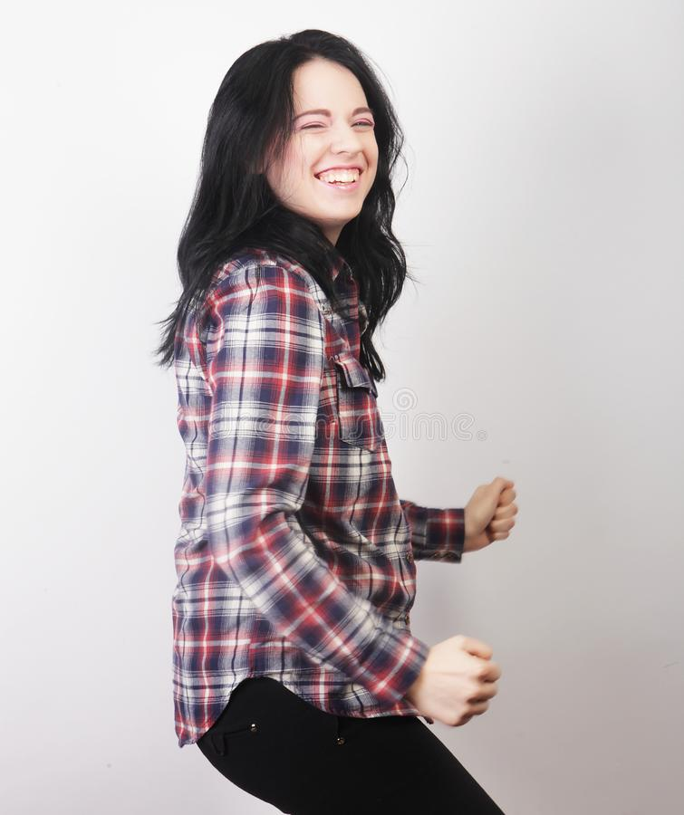 Woman wearing casual clothes, posing on white background. Beautiful young woman wearing casual clothes, posing on white background royalty free stock images