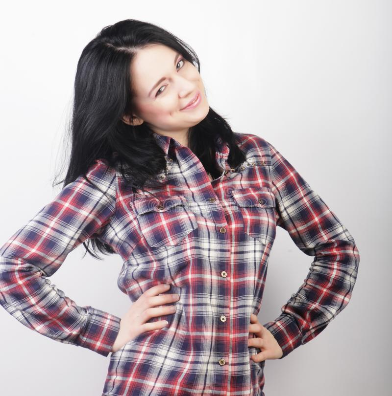 Woman wearing casual clothes, posing on white background. Beautiful young woman wearing casual clothes, posing on white background stock photography