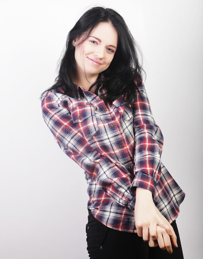 Woman wearing casual clothes, posing on white background. Beautiful young woman wearing casual clothes, posing on white background stock photo