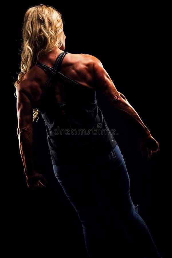 Woman Wearing Criss Cross Back Strap Top Flexing stock image