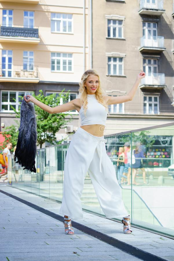 Woman wearing crop top and culottes. Elegant fashionable woman presenting trendy urban outfit. White crop top and trousers culottes. Outdoor photo session stock images