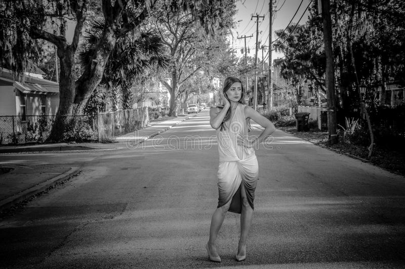 Woman Wearing Dress Standing on Center of Road stock images