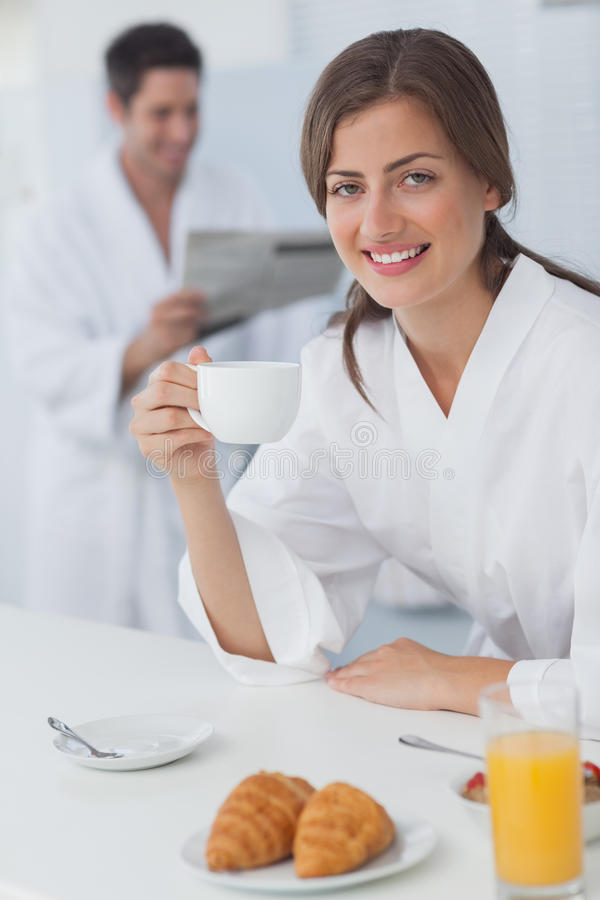 Download Woman Wearing A Dressing Gown Having Breakfast Stock Photo - Image of indoors, apartment: 32510196
