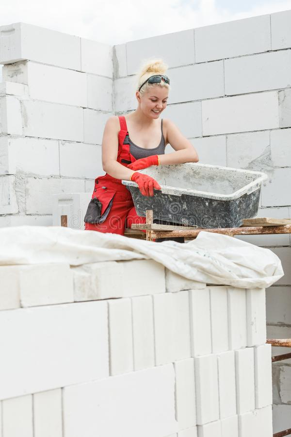 Woman working on home construction site royalty free stock images