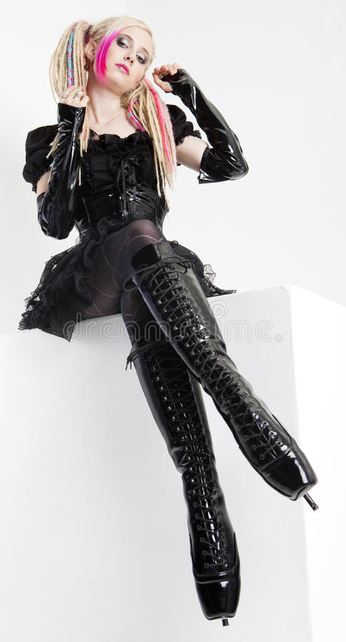 Woman Wearing Extravagant Clothes And Boots Stock Image