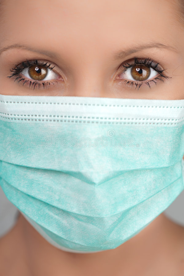 Woman wearing face mask stock image. Image of care, health