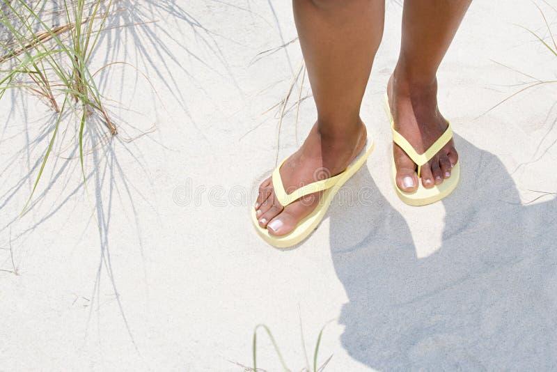 Woman wearing flip flops royalty free stock images