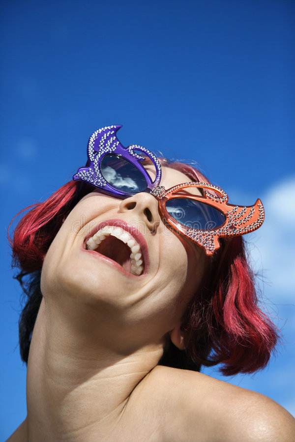 Woman wearing funky glasses. royalty free stock image
