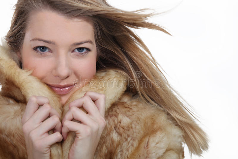 Download Woman wearing a fur coat stock image. Image of elegant - 26945515