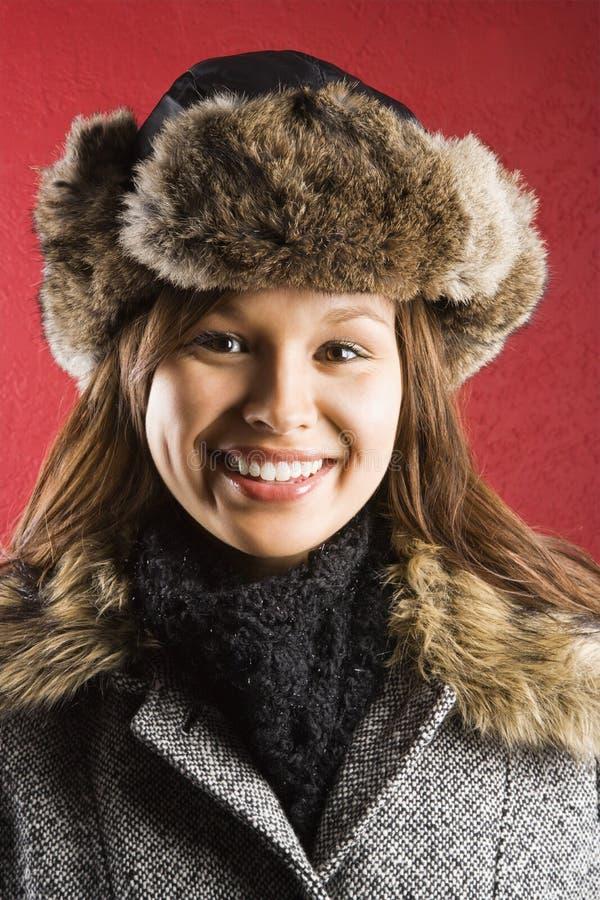 Woman wearing fur hat.