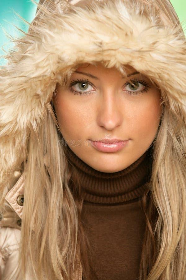 Woman wearing fur hood stock images